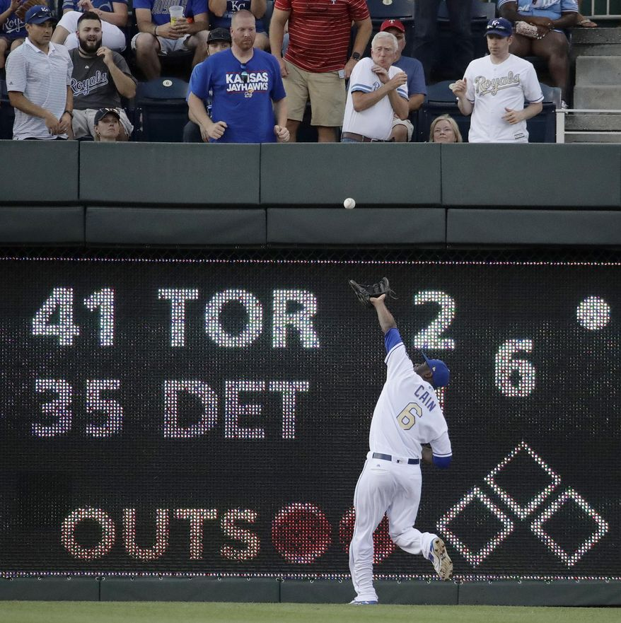 Kansas City Royals center fielder Lorenzo Cain catches a fly ball for the out hit into by Texas Rangers' Shin-Soo Choo during the third inning of a baseball game Friday, July 14, 2017, in Kansas City, Mo. (AP Photo/Charlie Riedel)