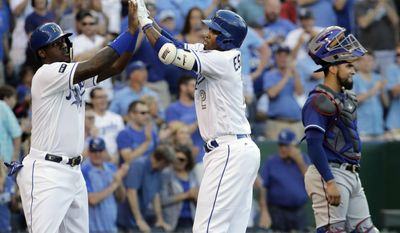 Kansas City Royals' Alcides Escobar, right, celebrates with Jorge Soler after hitting a two-run home run during the second inning of a baseball game against the Texas Rangers Friday, July 14, 2017, in Kansas City, Mo. (AP Photo/Charlie Riedel)