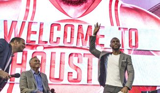 Chris Paul waves to fans after being introduced as the newest member of the Houston Rockets Friday, July 14, 2017, in Houston. The nine-time All-Star was traded from the Los Angeles Clippers late last month. (AP Photo/David J. Phillip)