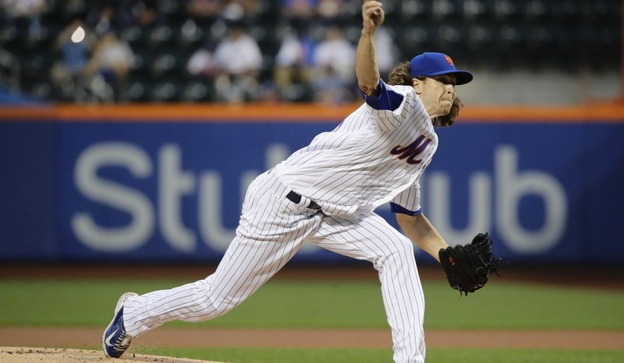 New York Mets' Jacob deGrom delivers a pitch during the first inning of a baseball game against the Colorado Rockies Friday, July 14, 2017, in New York. (AP Photo/Frank Franklin II)
