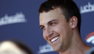 FILE - In this June 13, 2017, file photo, Denver Broncos quarterback Trevor Siemian jokes with reporters after the team's NFL football mandatory minicamp session, in Englewood, Colo. Siemian took a break from his private offseason workouts Friday, July 14, 2017, to lead 15 kids from the Jeffco Midget Football Association on a surprise shopping spree. The Broncos quarterback who will be competing with Paxton Lynch in the biggest position battle in the NFL this summer, was joined by rookies DeShaun Watson in Houston and Christian McCaffrey in Charlotte, North Carolina, to help kids affected by slashed sports budgets.(AP Photo/David Zalubowski, File)