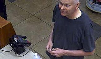 In this undated photo released by the FBI on July 14, 2017, Kentucky lawyer Eric Conn is seen on security footage at a New Mexico gas station. Conn, who pleaded guilty in March to stealing from the federal government and bribing a judge in a more than $500 million Social Security fraud case, disappeared June 2, a month before his sentencing. The FBI traced a truck he was driving to New Mexico, where it was abandoned, but said there is no indication that Conn has crossed into Mexico. (FBI via AP)