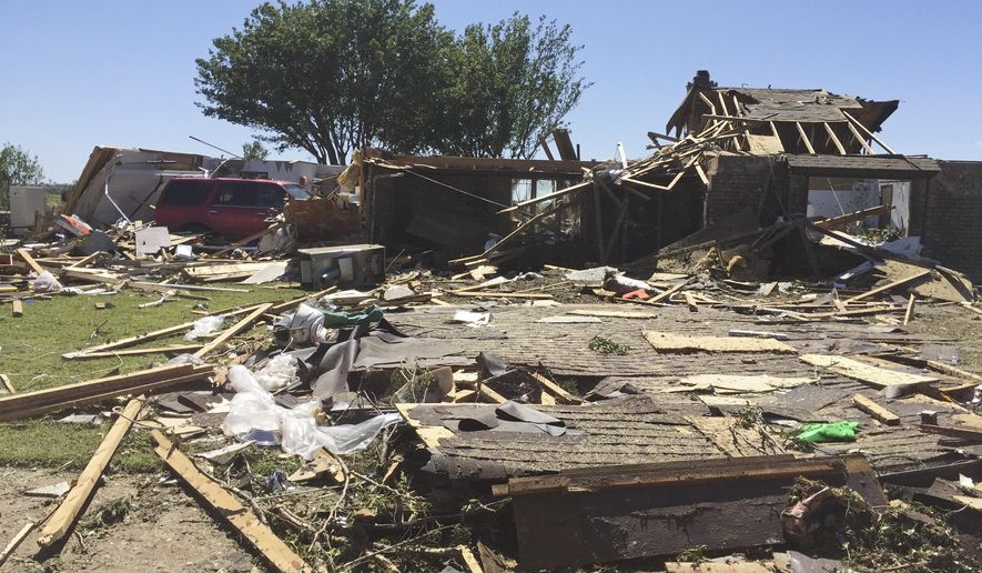 In this May 17, 2017, photo, a home sits destroyed in Elk City, Okla., the day after a tornado swept through the area, killing one. Researchers at the National Weather Center in Norman, Okla., said Friday, July 14, 2017, that it was able to tell 90 minutes before the storm struck that a specific storm cell would cause significant weather in the area. (AP Photo/Adam Kealoha Causey)