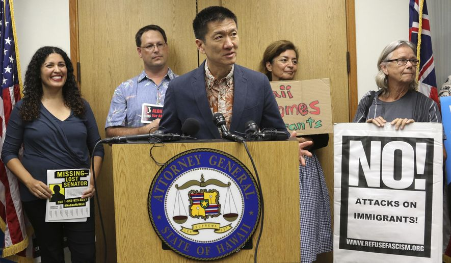 FILE - In this June 30, 2017, file photo, Hawaii Attorney General Douglas Chin speaks at a news conference about President Donald Donald Trump's travel ban in Honolulu. Hawaii's push to expand the list of relatives exempt from President Donald Trump's ban on travelers from six mostly Muslim countries is bogged down in court, where it has bounced from a federal judge to a federal appeals court and back to the same federal judge. (AP Photo/Caleb Jones, File)
