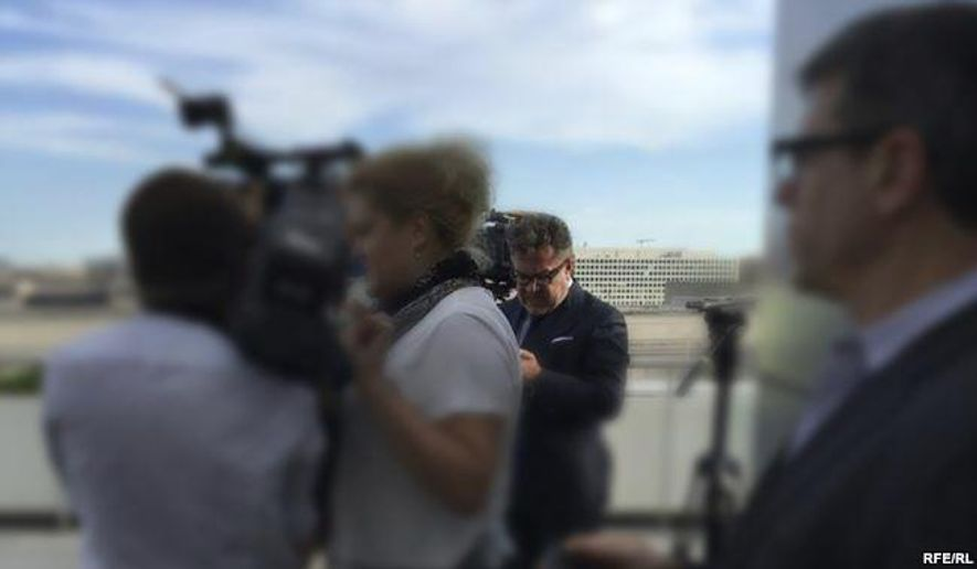 """In this photo provided by Radio Free Europe/Radio Liberty, Rinat Akhmetshin is photographed at the Newseum in Washington, June 13, 2016 after a documentary screening. Rep. Adam Schiff, ranking member on the Senate Intelligence Committee says reports that a second Russian person was in a meeting with Donald Trump Jr. last summer """"adds another deeply disturbing fact about this secret meeting."""" Akhmetshin confirmed his participation to The Associated Press on Friday, July 14, 2017.  (Radio Free Europe/Radio Liberty via AP)"""