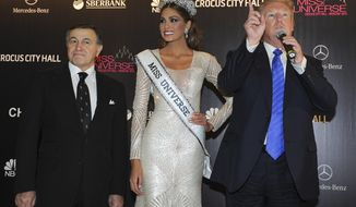 FILE - In this file photo taken on Sunday, Nov. 10, 2013, Russian businessman Aras Agalarov, left, Miss Universe 2013 Gabriela Isler, from Venezuela, center, and pageant owner Donald Trump, of the United States attend the final of the 2013 Miss Universe pageant in Moscow, Russia. A billionaire real estate mogul, his pop singer son, a music promoter, a property lawyer and Russia's prosecutor general are unlikely figures who surfaced in emails released by Donald Trump Jr. as his father's presidential campaign sought potentially damaging information in 2016 from Russia about his opponent, Hillary Clinton. (Irina Bujor/Kommersant Photo via AP, file) RUSSIA OUT