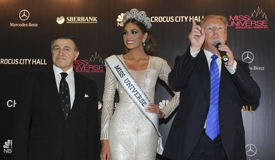 Gabriela Isler of Venezuela was crowned Miss Universe 2013 in a pageant owned by Donald Trump. Also at the Moscow event was Russian businessman Aras Agalarov. (Associated Press/File)