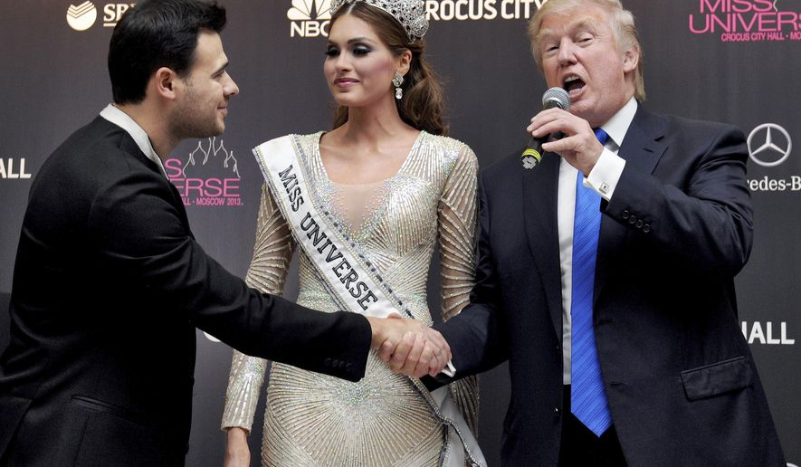 FILE In this file photo taken on Sunday, Nov. 10, 2013, Vice President of Crocus Group Emin Agalarov, left, Miss Universe 2013 Gabriela Isler, from Venezuela, center, and pageant owner Donald Trump, of the United States attend the final of the 2013 Miss Universe pageant in Moscow, Russia. A billionaire real estate mogul, his pop singer son Emin Agalarov, a music promoter, a property lawyer and Russia's prosecutor general are unlikely figures who surfaced in emails released by Donald Trump Jr. as his father's presidential campaign sought potentially damaging information in 2016 from Russia about his opponent, Hillary Clinton. (Irina Bujor/Kommersant Photo via AP, file) RUSSIA OUT