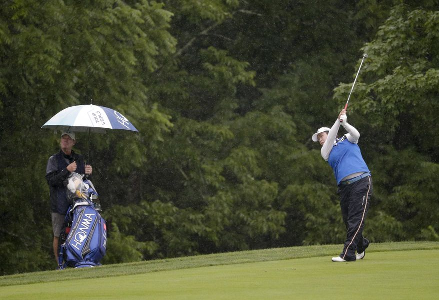 China's Shanshan Feng hits an approach shot on the second fairway during the second round of the U.S. Women's Open Golf tournament Friday, July 14, 2017, in Bedminster, N.J. (AP Photo/Seth Wenig)
