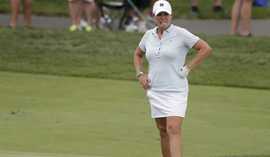 Cristie Kerr of the United States lines up a shot onto the 15th green during the first round of the U.S. Women's Open Golf tournament Thursday, July 13, 2017, in Bedminster, N.J. (AP Photo/Seth Wenig)