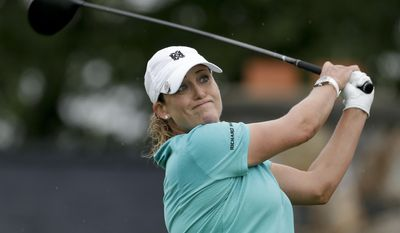 Cristie Kerr, of the United States, tees off the first hole during the second round of the U.S. Women's Open Golf tournament Friday, July 14, 2017, in Bedminster, N.J. (AP Photo/Seth Wenig)