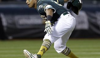 Oakland Athletics' Khris Davis celebrates after hitting a two-run home run off Cleveland Indians' Bryan Shaw during the ninth inning of a baseball game Saturday, July 15, 2017, in Oakland, Calif. The A's won 5-3. (AP Photo/Ben Margot)