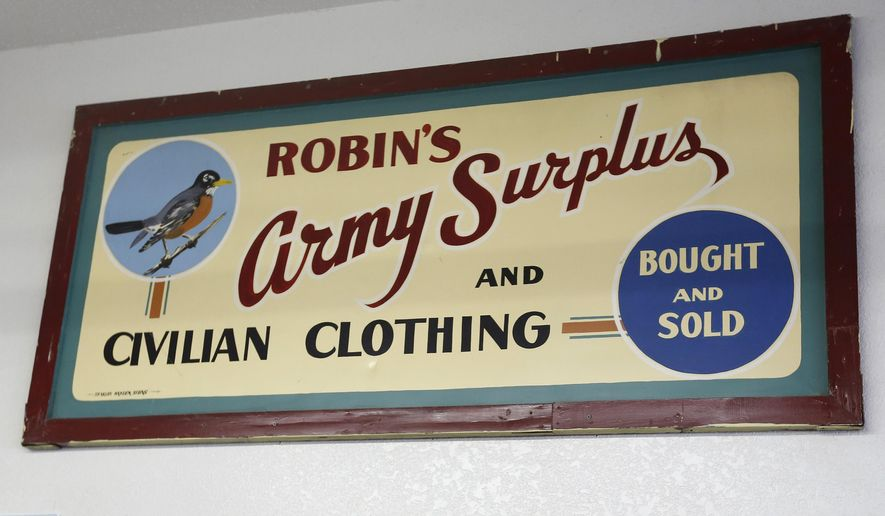 ADVANCE FOR USE SATURDAY, JULY 15 - In this Thursday, July 6, 2017, the ordinal hand painted sign hangs on the wall inside Robin's Surplus in Waterloo, Iowa. Robin's Surplus, a staple in downtown Waterloo since 1913, will wind down its business and close over the next two months. Business has trickle away to internet sales and big-box retailers over the past 10 years. (Matthew Putney/The Courier via AP)