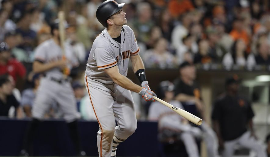 San Francisco Giants' Buster Posey watches his home run during the seventh inning of the baseball game against the San Diego Padres on Friday, July 14, 2017, in San Diego. (AP Photo/Gregory Bull)