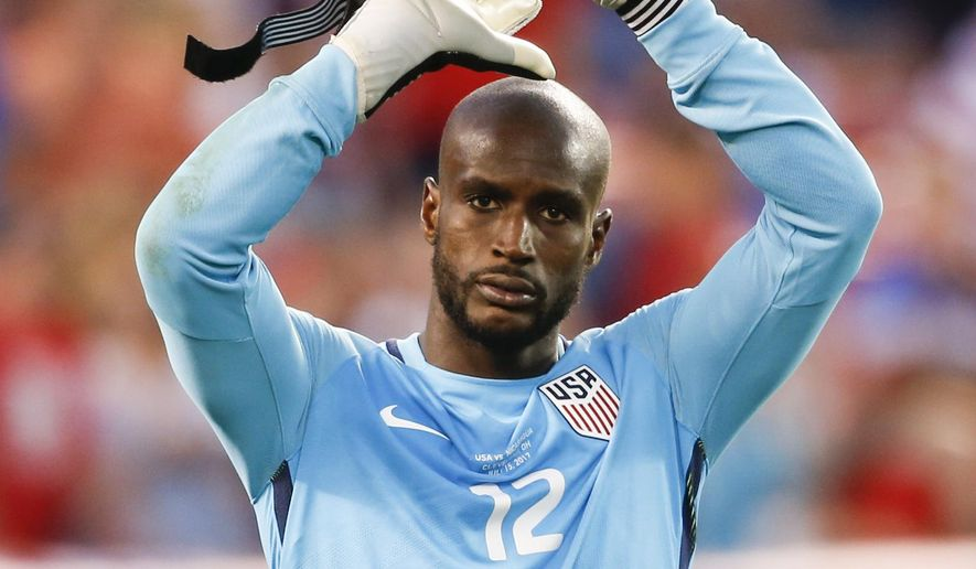 United States goalkeeper Bill Hamid (12) celebrates a victory over Nicaragua in a CONCACAF Gold Cup soccer match in Cleveland, Ohio, Saturday, July 15, 2017. (AP Photo/Ron Schwane)