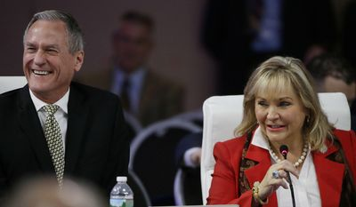 "Oklahoma Republican Gov. Mary Fallin and South Dakota Republican Gov. Dennis Daugaard, left, laugh as Fallin addresses a plenary session entitled ""The Workforce of Tomorrow"" on the third day of the National Governors Association's meeting Saturday, July 15, 2017, in Providence, R.I. (AP Photo/Stephan Savoia)"