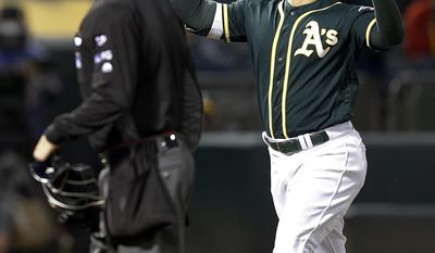Oakland Athletics' Yonder Alonso celebrates after hitting a home run off Cleveland Indians' Carlos Carrasco during the fifth inning of a baseball game Friday, July 14, 2017, in Oakland, Calif. (AP Photo/Ben Margot)