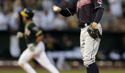 Cleveland Indians' Corey Kluber, right, waits for Oakland Athletics' Matt Chapman to run the bases after hitting a home run during the eighth inning of a baseball game Saturday, July 15, 2017, in Oakland, Calif. (AP Photo/Ben Margot)