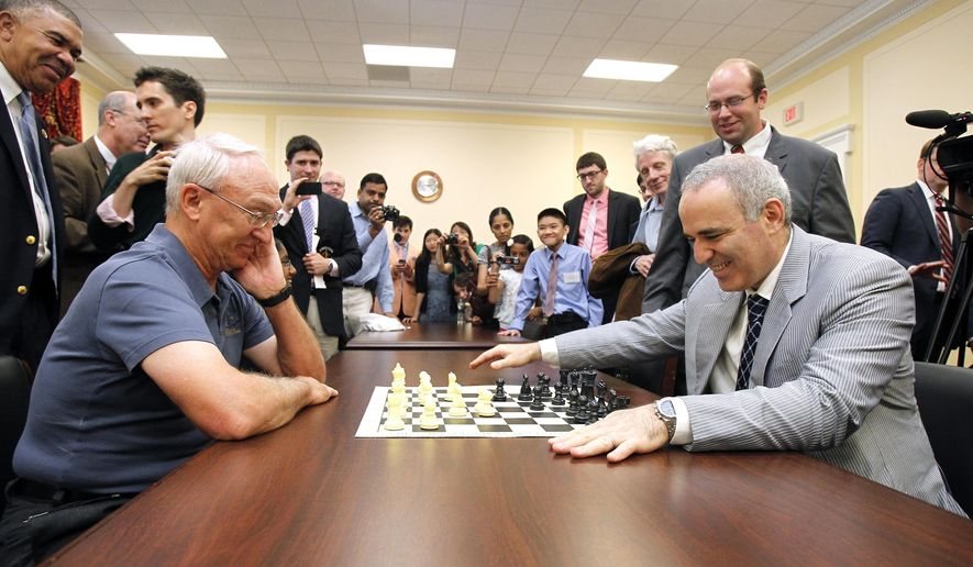 In this June 18, 2014, photo, World Chess Champion Garry Kasparov, right, and Rex Sinquefield, founder and president of the Board of Directors of the St. Louis Chess Club, kick-off the first-ever Congressional Chess Match at the Rayburn House Office Building in Washington. Kasparov, who has been retired from competitive play since 2005, is returning to competition on Aug. 14-19, 2017, at the Chess Club and Scholastic Center of St. Louis. (Photo by Paul Morigi/Invision for Invision for Saint Louis Chess Club/AP Images)