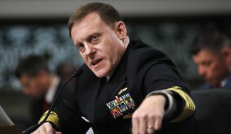 In this May 9, 2017, file photo, U.S. Cyber Command and the National Security Agency Director Adm. Mike Rogers testifies on Capitol Hill in Washington. (AP Photo/Jacquelyn Martin, File)