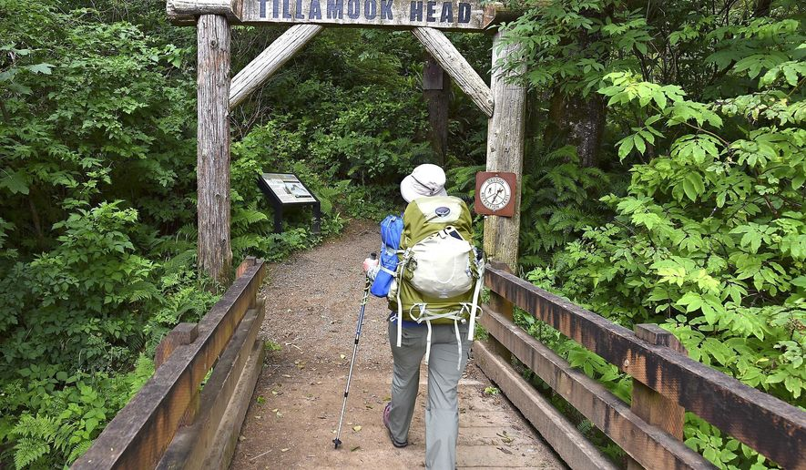 ADVANCE FOR THE WEEKEND OF JULY 15-16 AND THEREAFTER -  In this June 29, 2017 photo, Tanya Gephart starts a trip on the Tillamook Head Trail portion of the Oregon Coast Trail near Seaside, Ore. More and more hikers who were on the Pacific Coast Trail are moving to the Oregon Coast Trail due to weather conditions. (Colin Murphey/The Daily Astorian via AP)