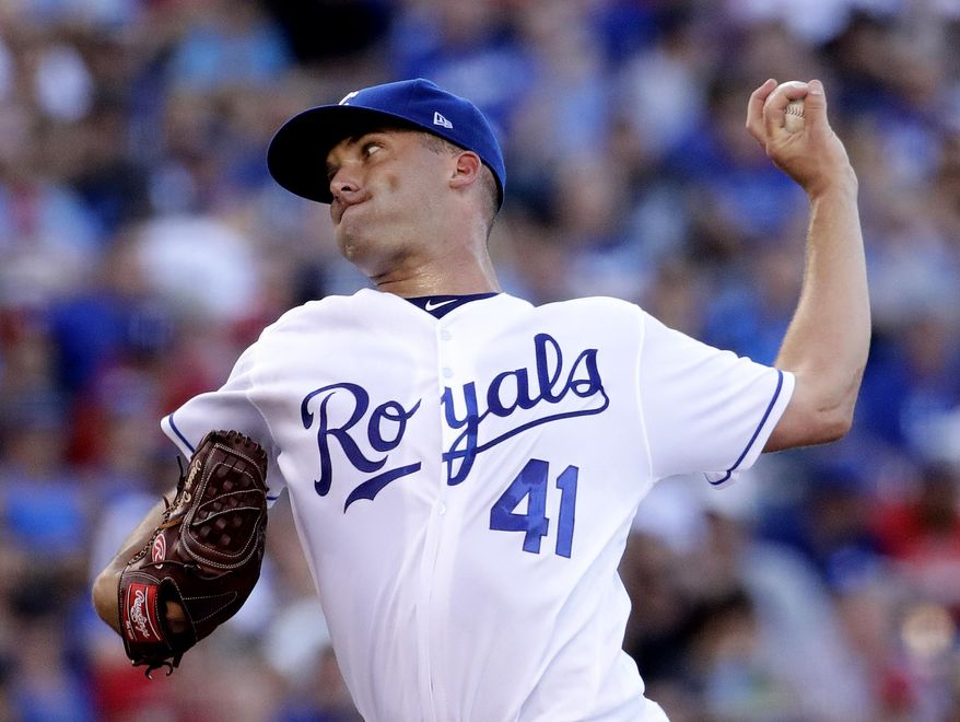 Kansas City Royals starting pitcher Danny Duffy throws during the third inning of the team's baseball game against the Texas Rangers on Saturday, July 15, 2017, in Kansas City, Mo. (AP Photo/Charlie Riedel)