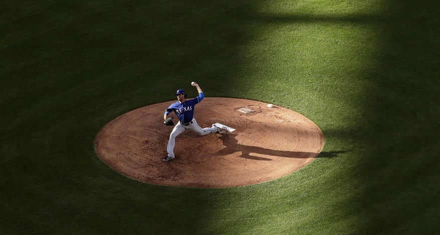 Texas Rangers starting pitcher Cole Hamels throws during the first inning of the team's baseball game against the Kansas City Royals on Saturday, July 15, 2017, in Kansas City, Mo. (AP Photo/Charlie Riedel)