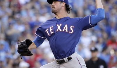 Texas Rangers starting pitcher Cole Hamels throws during the third inning of the team's baseball game against the Kansas City Royals on Saturday, July 15, 2017, in Kansas City, Mo. (AP Photo/Charlie Riedel)