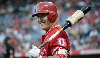 Los Angeles Angels' Mike Trout smiles while getting ready to bat during the first inning of the team's baseball game against the Tampa Bay Rays, Friday, July 14, 2017, in Anaheim, Calif. (AP Photo/Jae C. Hong)