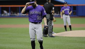 Colorado Rockies starting pitcher Tyler Chatwood (32) leaves the field during the first inning of the team's baseball game against the New York Mets on Saturday, July 15, 2017, in New York. (AP Photo/Frank Franklin II)