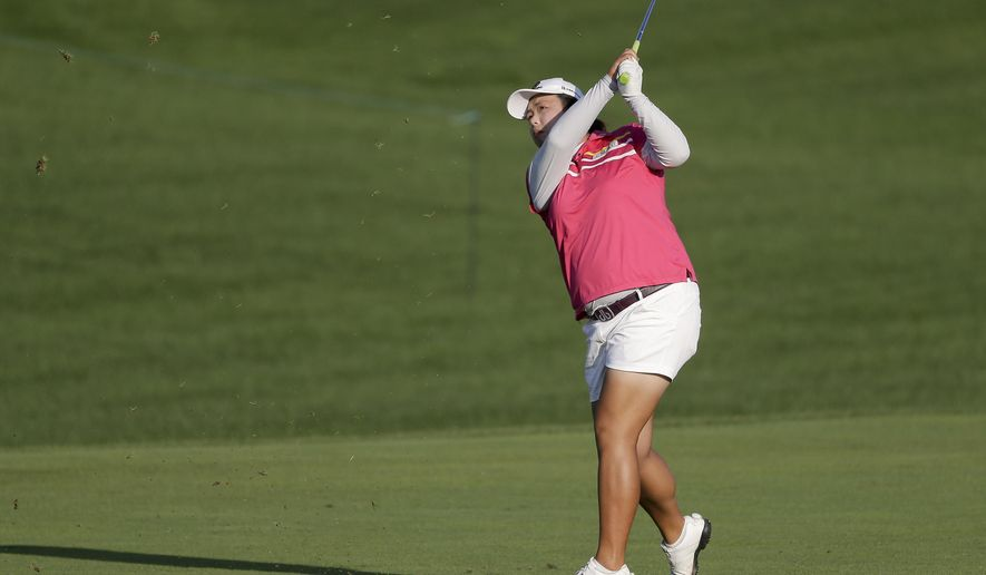 China's Shanshan Feng hits a shot from the 18th fairway during the third round of the U.S. Women's Open Golf tournament Saturday, July 15, 2017, in Bedminster, N.J. (AP Photo/Seth Wenig)