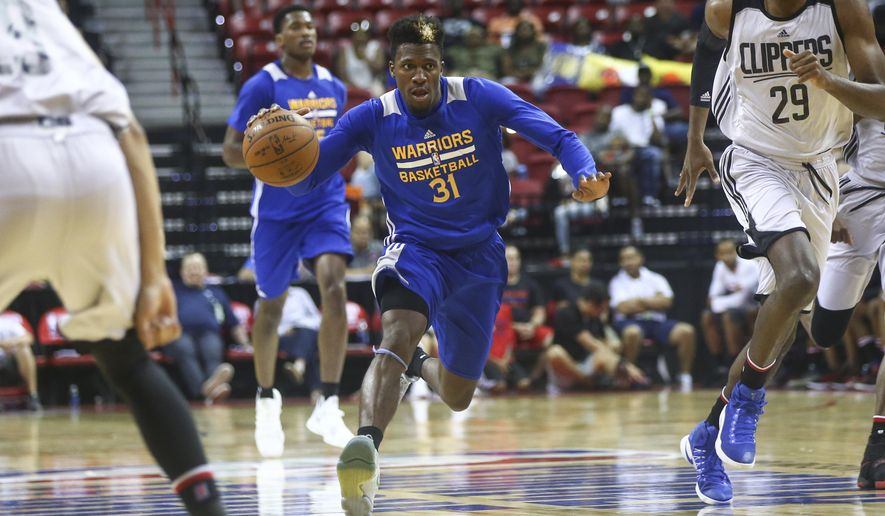 Golden State Warriors' Dylan Ennis (31) drives against the Los Angeles Clippers during an NBA summer league basketball game in Las Vegas on Friday, July 14, 2017. (Chase Stevens/Las Vegas Review-Journal via AP)