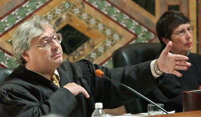 FILE - In this Sept. 22, 2003, file photo, Judge Alex Kozinski, of the 9th U.S. Circuit Court of Appeals, gestures as Chief Judge Mary Schroeder looks on in San Francisco. The nation's largest federal court circuit is set for its annual meeting after a contentious six months that has seen its judges repeatedly clash with President Donald Trump, and its agenda is not shying away from topics that have stoked the president's ire. Immigration, the news media and meddling in the U.S. election are among the subjects that will be discussed at the 9th Circuit's four-day conference in San Francisco that begins on Monday, July 17, 2017. (AP Photo/Paul Sakuma, Pool, File)