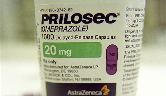 Capsules of Prilosec, the world's best selling ulcer medication, are seen displayed in front of their container Tuesday, Jan. 22, 2002 in Boston.  AstraZeneca PLC, the maker of Prilosec, is being questioned by the Federal Trade Commission into patent issues about the medication. (AP Photo/SEVANS)