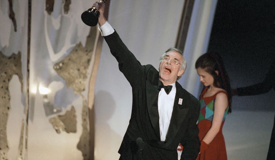 """Martin Landau raises his Oscar for Best Supporting Actor for his performance in """"Ed Wood"""" on Monday, March 27, 1995 in Los Angeles during 67th Annual Academy Awards.  Standing to the right of  Landau is presenter Ana Paquin, last year's Best Supporting Actress for her role in """"The Piano.""""  (AP Photo/Michael Caulfield)"""