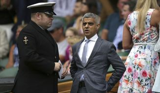 London Mayor Sadiq Khan arrives in the Royal Box for the Men's Singles final match between Switzerland's Roger Federer and Croatia's Marin Cilic on day thirteen at the Wimbledon Tennis Championships in London Sunday, July 16, 2017. (Daniel Leal-Olivas/Pool Photo via AP)
