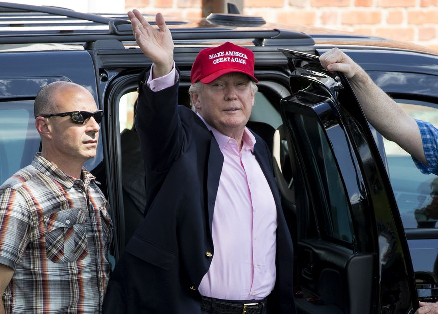 U.S. President Donald Trump arrives to enter his presidential viewing stand, Sunday, July 16, 2017, during the U.S. Women's Open Golf tournament at Trump National Golf Club in Bedminster, N.J. (AP Photo/Carolyn Kaster)