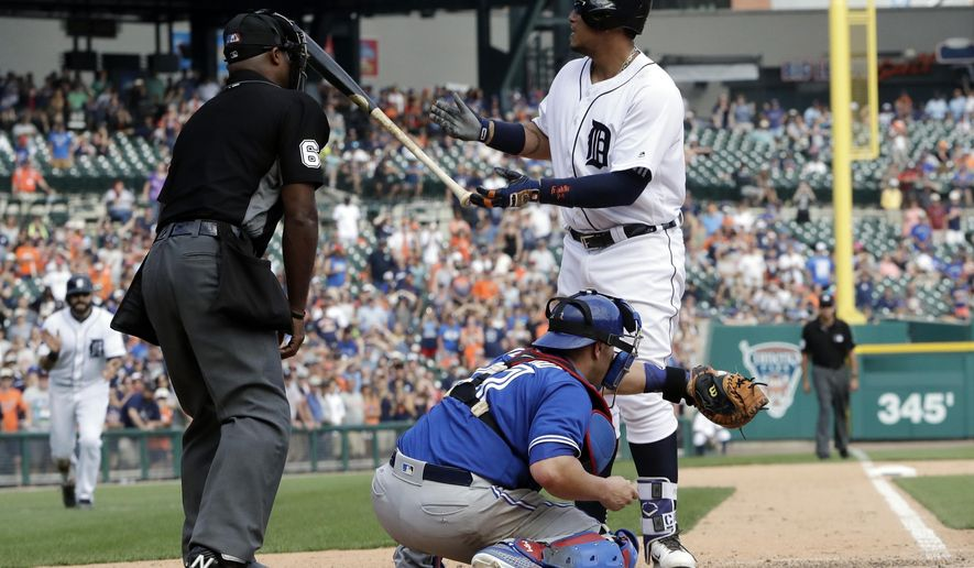 Detroit Tigers' Miguel Cabrera tosses his bat after being awarded a bases-loaded walk to defeat the Toronto Blue Jays in the 11th inning of a baseball game, Sunday, July 16, 2017, in Detroit. (AP Photo/Carlos Osorio)