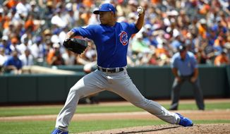 Chicago Cubs starting pitcher Jose Quintana throws to the Baltimore Orioles in the second inning of a baseball game in Baltimore, Sunday, July 16, 2017. (AP Photo/Patrick Semansky)