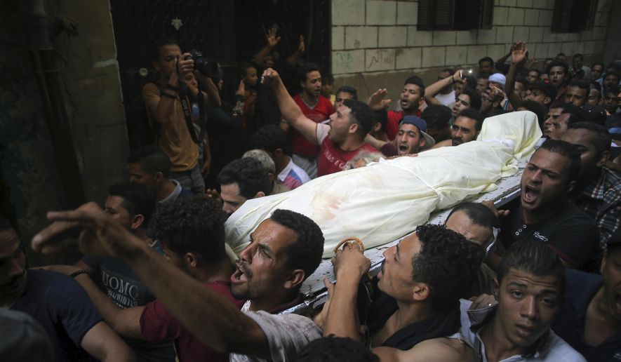 People carry the body of Sayed Tafshan, who died during clashes between security forces and residents of al-Waraq island, on the southern fringes of Cairo, Egypt, Sunday, July 16, 2017. Egypt's Health Ministry said one person was killed and 19 injured in clashes after police attempted to remove illegal buildings on state land on the island. Egypt's Interior Ministry said 31 policemen were injured. (AP Photo/Mostafa Darwish)