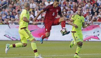 FILE - In this Saturday, June 3, 2017, file photo, United States forward Clint Dempsey (8) controls the ball as Venezuela's Jose Manuel Velazquez, left, and Pablo Camacho (17) defend in the first half during an international friendly match  in Sandy, Utah. On Sunday, July 16, 2017, the U.S. Soccer Federation announced that Dempsey, midfielder Michael Bradley and goalkeeper Tim Howard are among six additions to the U.S. roster for the knockout phase of the CONCACAF Gold Cup. U.S. coach Bruce Arena also added forward Jozy Altidore, midfielder Darlington Nagbe and goalkeeper Jesse Gonzalez. (AP Photo/Rick Bowmer, File)