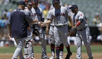 Cleveland Indians' Trevor Bauer, center, hands the ball to manager Terry Francona, left, as he is removed in the first inning of a baseball game against the Oakland Athletics, Sunday, July 16, 2017, in Oakland, Calif. (AP Photo/Ben Margot)