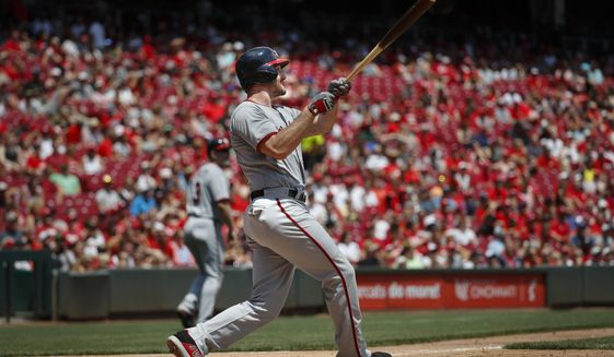 Washington Nationals' Daniel Murphy hits a three-run home run off Cincinnati Reds starting pitcher Homer Bailey in the fifth inning of a baseball game, Sunday, July 16, 2017, in Cincinnati. (AP Photo/John Minchillo)