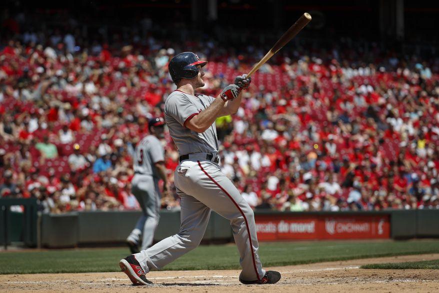 Washington Nationals' Daniel Murphy hits a three-run home run off Cincinnati Reds starting pitcher Homer Bailey in the fifth inning of a baseball game, Sunday, July 16, 2017, in Cincinnati. (AP Photo/John Minchillo)