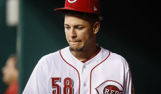 Cincinnati Reds starting pitcher Luis Castillo walks through the dugout during the seventh inning of the team's baseball game against the Washington Nationals, Saturday, July 15, 2017, in Cincinnati. (AP Photo/John Minchillo)