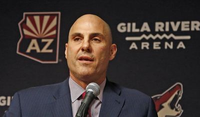 FILE - In this July 13, 2017, file photo, Rick Tocchet, the new coach of the Arizona Coyotes, speaks during a news conference  in Glendale, Ariz. Three of the six NHL coaching vacancies this offseason were filled by first-timers as teams look to find the next new idea rather than recycling the past. Only Dallas' Ken Hitchcock could be considered experienced, while Arizona's Rick Tocchet has less than two full seasons of experience and Los Angeles' John Stevens parts of four years. (AP Photo/Ross D. Franklin)