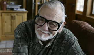 """FILE - In this Monday, Jan. 21, 2008 file photo, director and writer George Romero poses for a photograph while talking about his film """"Diary of the Dead' at the Sundance Film Festival in Park City, Utah. George Romero, whose classic """"Night of the Living Dead"""" and other horror films turned zombie movies into social commentaries and who saw his flesh-devouring undead spawn countless imitators, remakes and homages, has died. He was 77. Romero died Sunday, July 16, 2017 following a battle with lung cancer. (AP Photo/Amy Sancetta, File)"""