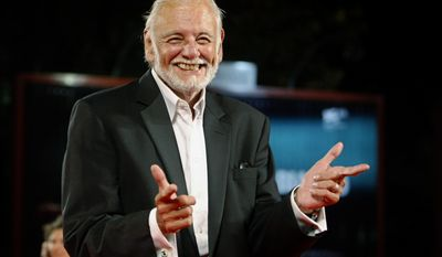 """FILE - In this Sept. 9, 2009, file photo, director George Romero arrives for the screening of the film """"Survival Of The Dead"""" at the 66th edition of the Venice Film Festival in Venice, Italy. Romero, whose classic """"Night of the Living Dead"""" and other horror films turned zombie movies into social commentaries and who saw his flesh-devouring undead spawn countless imitators, remakes and homages, has died. He was 77. Romero died Sunday, July 16, 2017, following a battle with lung cancer, said his family in a statement provided by his manager Chris Roe. (AP Photo/Andrew Medichini, File)"""