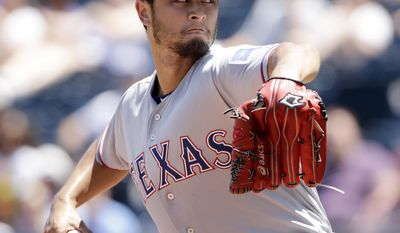 Texas Rangers starting pitcher Yu Darvish throws during the second inning of a baseball game against the Kansas City Royals, Sunday, July 16, 2017, in Kansas City, Mo. (AP Photo/Charlie Riedel)