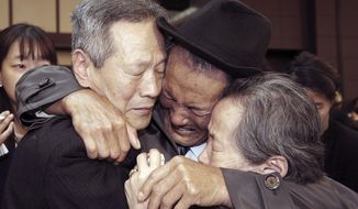 FILE - In this Oct. 22, 2015, file photo, North Korean Son Kwon Geun, center, weeps with his South Korean relatives as he bids farewell after the Separated Family Reunion Meeting at Diamond Mountain resort in North Korea. South Korea's Red Cross said on Monday, July 17, 2017, it wants separate talks at the border village on Aug. 1 to discuss family reunions. (Korea Pool Photo via AP, File)